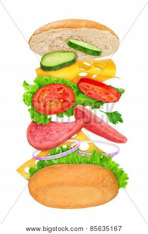 Falling Sandwich With Ingredients In The Air On A White Background