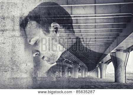 Sad stressed young man with concrete wall background