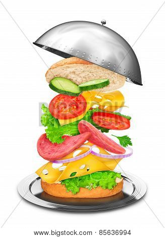 Delicious Sandwich With Ingredients In The Air At The Restaurant Cloche White Background