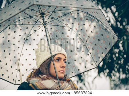 Young Girl Holding Umbrella In An Autumn Rainy Day