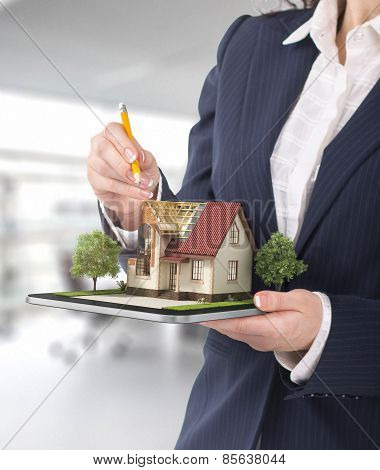 Project Concept. Demonstration Of An Architectural Project. Man Draws A House Project On The Tablet.