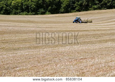 Tractor Seeding Field For Summer Crops