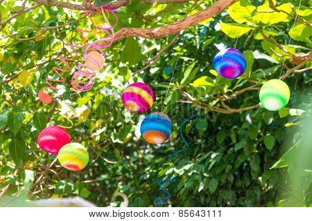 colorful balls as decoration in small outdoor cafe/restaurant in tropics, summer vacations