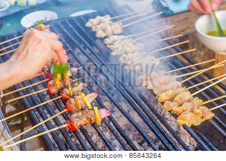 many bbq sticks on grill, outdoor, summer bbq time