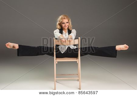 Beauty Blond Woman On Chair In Ballet Pose