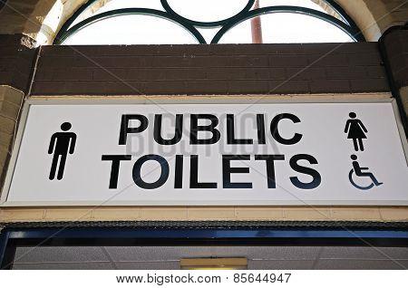 Public toilets sign.