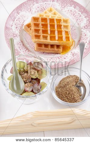 Breakfast On A Serving Tray With Grape, Waffle And Milled Flaxseed