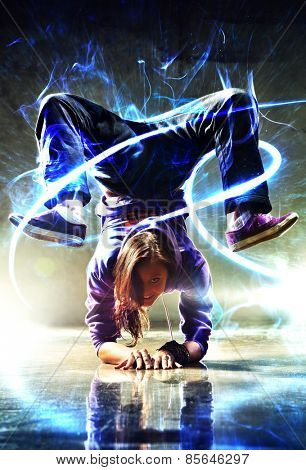 Young woman modern dancer. With lights and glow energy effect.