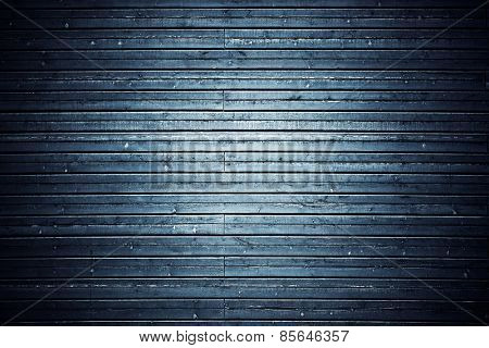 Wooden background. Dark contrast colors.