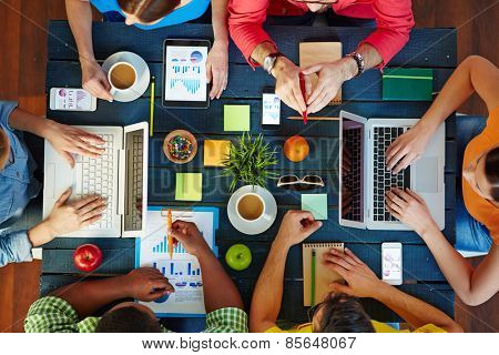 High angle view of people working together at one table