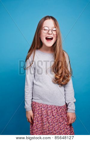 Little girl with closed eyes crying