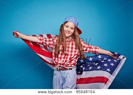 Cute girl keeping American flag