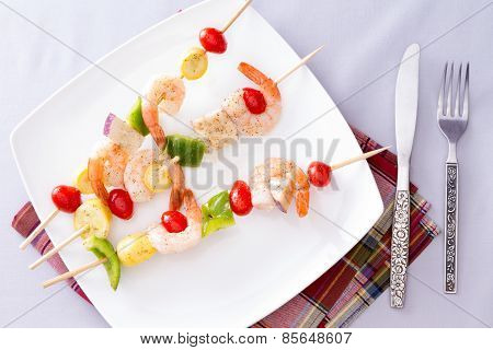 Gourmet Shrimp Skewers Or Kebabs On White Plate