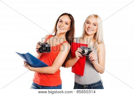 Two female students with photocamera. Students concept. Isolated on white
