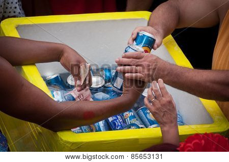 Man selling cans of beer during Rio de Janeiro carnival