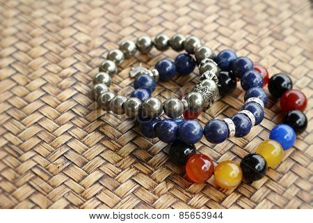 Beautiful Bracelets Placed On The Wooden Background