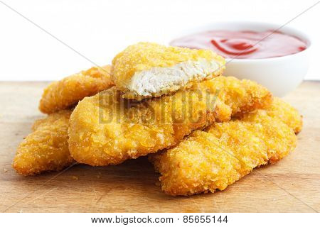 Golden fried bread crumbed chicken strips.