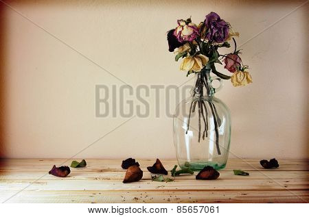 Still Life With Flowers On Wooden Table Over Grunge Background, Vintage Style.