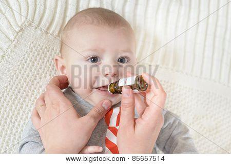 Newborn Baby Gets Medicine