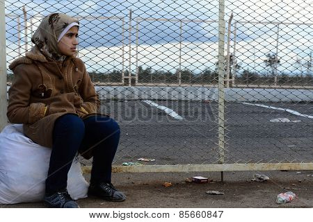Sad young girl - refugee
