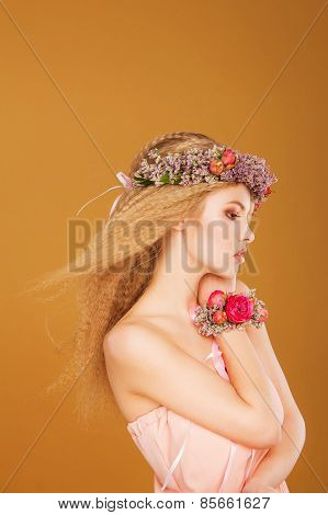 young model with wreath of bright flowers on her head