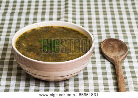 Lentil stew on tablecloth