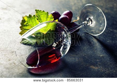 Glass of red wine on dark background
