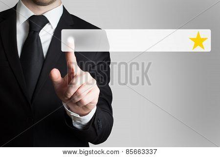 Businessman Pushing Button Golden Star
