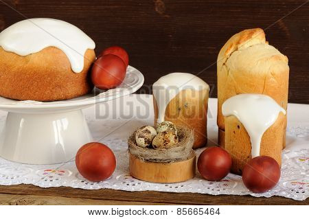 Kulichi, Traditional Russian Easter Cakes, Dyed Eggs And Bird Nest On White Cloth