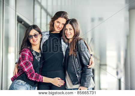 Three Teen Girl Friends Laughing. Selective focus