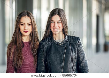 Two Teen Girl Friends Laughing. Selective focus