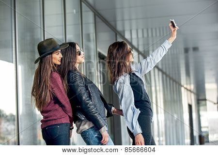 Happy girls taking a Selfie. Selective focus