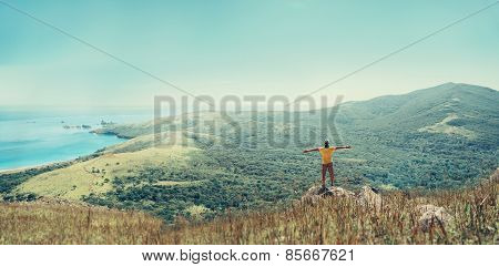 Traveler Man Standing On Peak Of Mountain Near The Sea