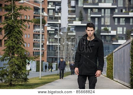 Stylish Young Handsome Man in Black Coat Standing in City Center