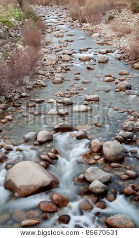 Nice course of a river with many stones
