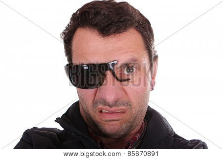 man with broken glasses