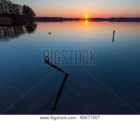Lake At Sunset. Boats Mooring Place.