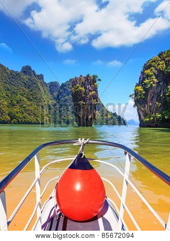 Fabulous holiday in Thailand. Bay in the Andaman Sea and tropical exotic island. A boat trip with a red lantern
