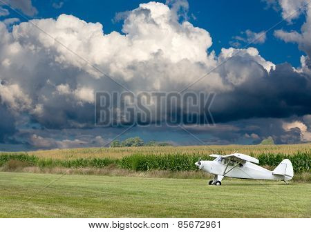 Small White Microlight Plane Ready For Take Off