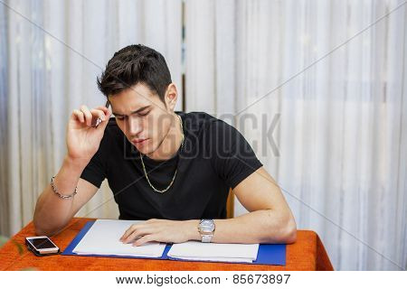 Handsome Young Man Studying Or Doing Homework