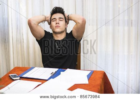 Tired Or Despondent Young Man Doing Homework