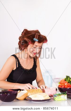 Young Pretty Woman Housewife Cooking With Curlers Hair