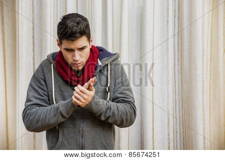 Sick Young Man With Flu Or Cold Wearing Scarf