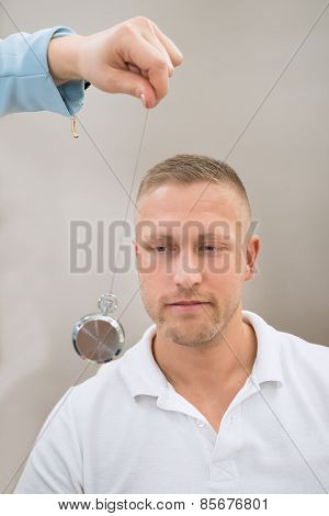 Psychiatrist Hypnotizing Patient With Pendulum