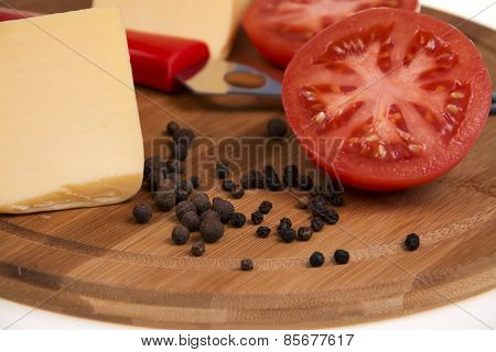 Pepper Tomato And Cheese On The Kitchen Board