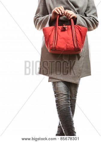 Woman In Gray Coat Holds Red Handbag