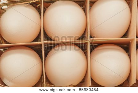 wooden egg tray with eggs
