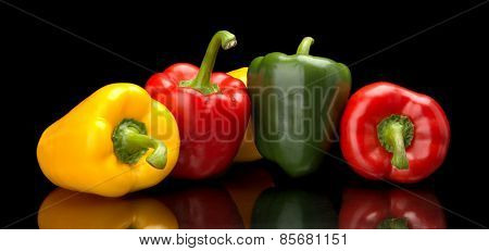 Red,green,yellow Bell Peppers Isolated On Black