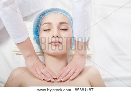 Beautiful young woman undergoing a massage