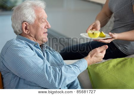 Daughter Caring About Senior Father